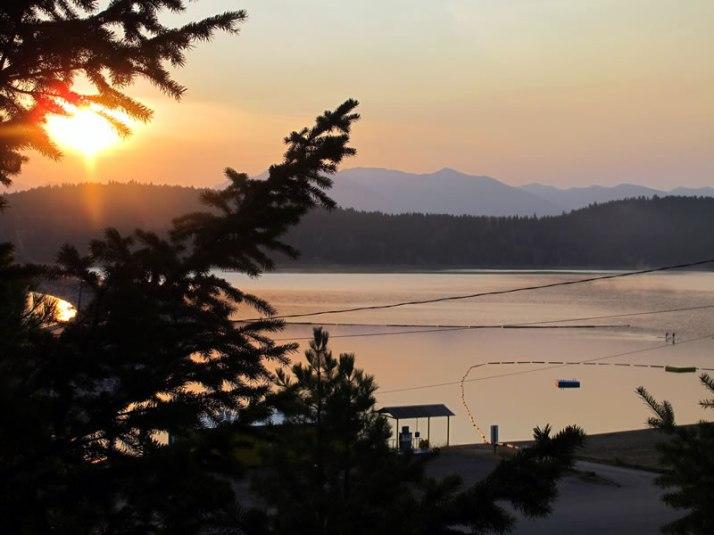 Paddle Boarders Enjoying Sunrise at Lake Koocanusa
