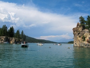 Boaters enjoying the cliffs and islands on the north part of Koocanusa